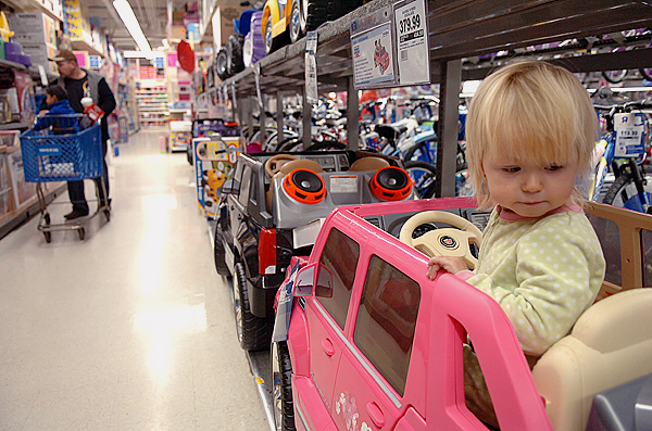 Reagan Haycock, 20 months, of Milbridge tries out a new ride in her pajamas at Toys 'R' Us in Bangor on Black Friday, Nov. 27, 2009. &quotShe loves it,&quot said her mother Heather Knapp of Reagan's second year shopping on Black Friday. (Bangor Daily News/Bridget Brown)