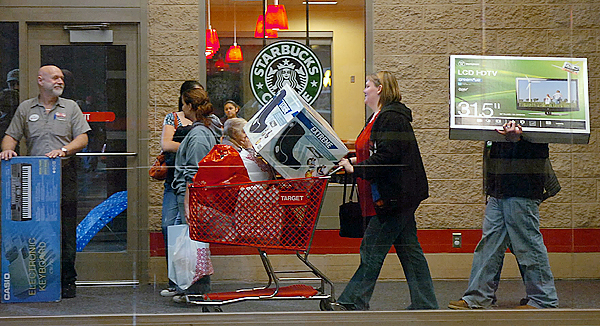 Shoppers exit Target in Bangor with merchandise shortly after the store opened for business on Black Friday, Nov. 27, 2009. (Bangor Daily News/Bridget Brown)