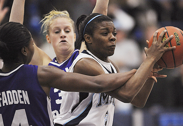 Maine's Brittany Williams, right, gets tangled with Holy Cross's Brianna McFadden, left, as Holy Cross guard, Christie Cushnie, center, helps defend during first period action on Friday, November 27, 2009 at Orono. (Bangor Daily News/Kevin Bennett)