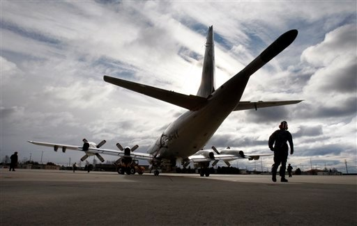 One of the last two P3 Orions is moved onto the tarmac as it prepares for the final flight at Brunswick Naval Air Station, Saturday, Nov. 28, 2009, in Brunswick, Maine. The base is relocating its aircraft and personnel to the naval air station in Jacksonville, Fla. (AP Photo/Robert F. Bukaty)