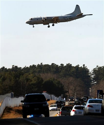 In this Thursday, Nov. 19, 2009 photo, one of the last remaining P-3 Orion planes heads for a landing at the Brunswick Naval Air Station in Brunswick, Maine. The last plane is scheduled to leave the base the weekend after Thanksgiving and the entire base is scheduled to be closed in 2011. (AP Photo/Pat Wellenbach)