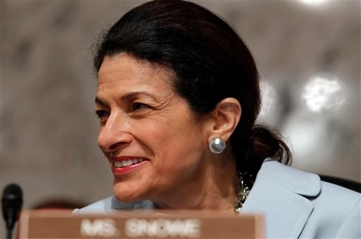 FILE - In this Oct. 13, 2009 file photo, Senate Finance Committee member Sen. Olympia Snowe, R-Maine, smiles as she looks towards the Democratic side of the dais on Capitol Hill in Washington. Snowe, who swept to a third term in 2006 with 74 percent of the vote, is the only Senate Republican to vote for Democratic health care legislation. (AP Photo/Charles Dharapak, File)