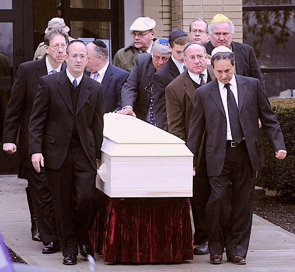 Sonny Miller's casket is taken from Congregation Beth Israel to a hearse following a funeral service in Bangor on Monday, Nov. 30, 2009.