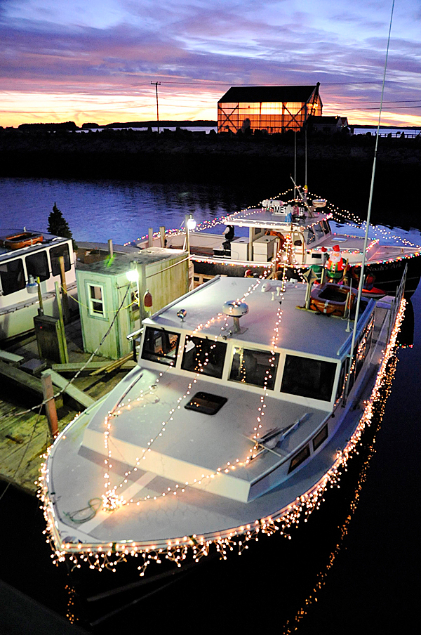 A few hours before joining the holiday flotilla on Moosabec Reach Sunday evening, November 29, 2009, lobster boats &quotDebbie D&quot and &quotNoah's Ark&quot  were decked in festive lighting and other decorations as the sun set in Jonesport.