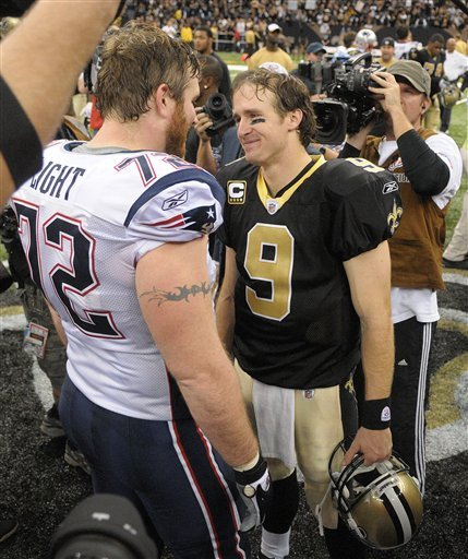 New England Patriots offensive tackle Matt Light and New Orleans Saints quarterback Drew Brees talk after the Saints win in the Superdome in New Orleans on Nov. 30, 2009. The Saints beat the Patriots 38-17 to remain undefeated this season. (AP Photo/Matt Bush/The American)