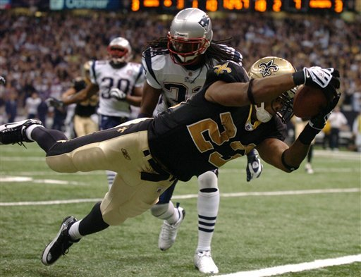 New Orleans Saints running back Pierre Thomas (23) dives into the endzone  in the Superdome in New Orleans on November 30, 2009. The Saints beat the Patriots 38-17. (AP Photo/Matt Bush/The American)