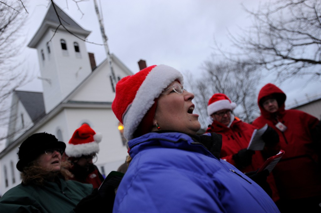 Val Starbird (center) of Greenville and other members of the Greenville Community Choir sang Christmas carols during the C.A. Dean Lights of Life Tree Lighting in front of Union Church U.C.C. at sunset. The capped off the Deck The Halls holiday events in Greenville, Maine Saturday, November 28, 2009. (Bangor Daily News)