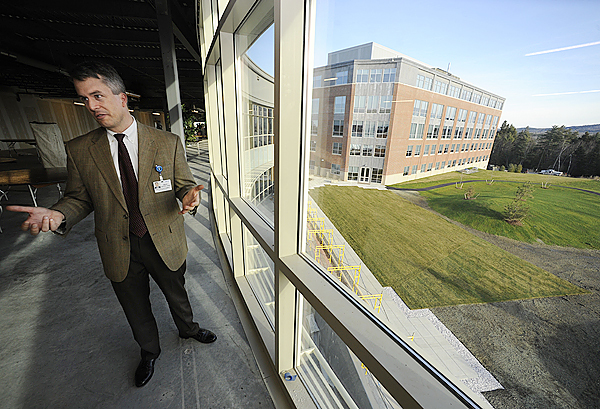 Brad Coffey, Champion the Cure director, shows off the third floor of the new Lafayette Family Cancer Center on Whiting Hill in Brewer. In the background (outside) is EMHS's Cianchette Building. (Bangor Daily News/John Clarke Russ)