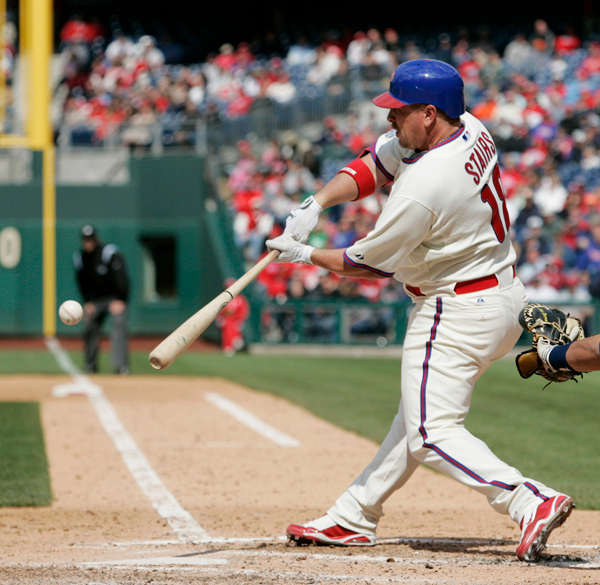 Matt Stairs of Philadelphia connects for a pinch-hit home run off Milwaukee's Dave Bush in the eighth inning of Thursday's game in Philadelphia. (AP Photo/Tom Mihalek)
