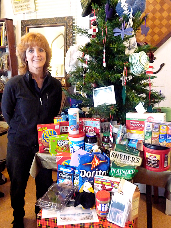 Liz Henry of East Machias is collecting items and cash for postage to send holiday packages to service men and women in Iraq and Afghanistan. To encourage donations, Henry has organized a Winterfest for Friday and Saturday, Dec. 11 and 12. At the festival, several local businesses will be open and offering items at special prices and on Friday, the Washington Academy Choir will sing carols.