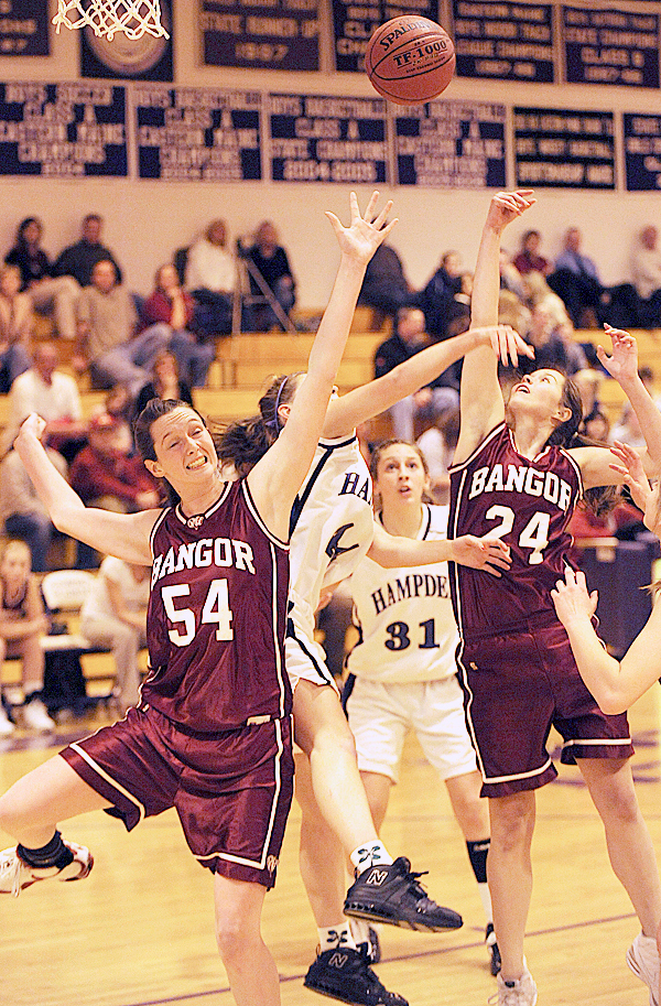 Bangor's Kate Treadwell(54) and Kate Freudenberger (24) fight for a rebound with Hampden's Julia Snyder (center) as  Hampden's  Whitney Moore(31) watches at Hampden Academy gym on Friday, December 4, 2009.