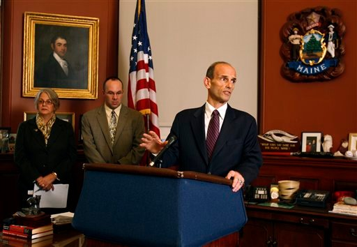 Maine Gov. John Baldacci speaks at a news conference to announce his decision to curtail spending by $63 million because of a nearly $400 million revenue shortfall, Friday, Nov. 20, 2009, at the State House in Augusta, Maine. Brenda Harvey, commissioner of Health and Human Services, left, and Finance Commissioner Ryan Lowe accompany the governor. (AP Photo/Robert F. Bukaty)