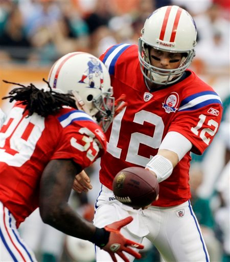 New England Patriots quarterback Tom Brady (12) passes to New England Patriots running back Laurence Maroney (39) during the second quarter against the Miami Dolphins during an NFL  football game in Miami, Sunday, Dec. 6, 2009. (AP Photo/Lynne Sladky)