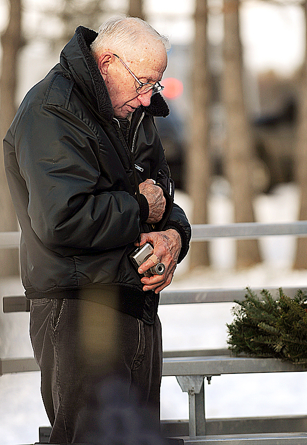 Shivering against the cold, Korean war veteran Ken Gray of Hermon, removes his hat for a moment of silence after the dedication of the Hermon Veteran's Memorial Park on Sunday, December 6, 2009. (Bangor Daily News/Kevin Bennett)