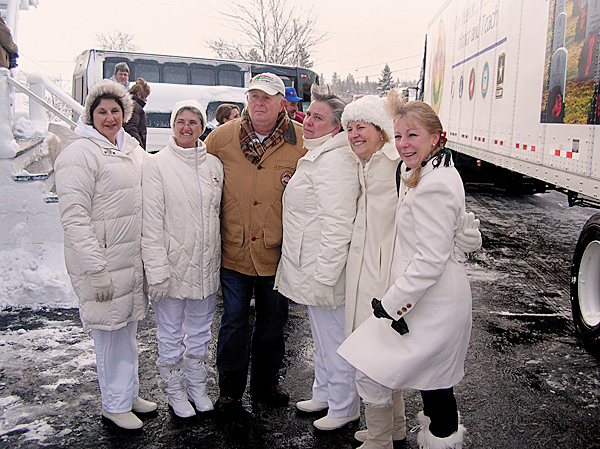 Morrill Worcester of Worcester Wreaths in Harrington is surrounded by a contingent of Gold Star Mothers, members of the organization's national board, who joined the convoy that left Harrington Sunday to deliver wreaths to be placed on the graves of those buried at Arlington National Cemetery.