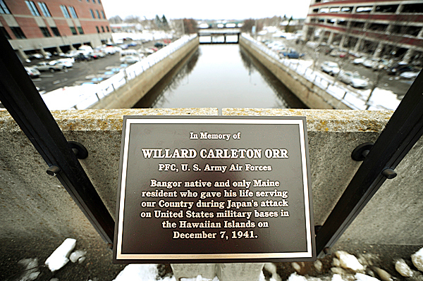 A plaque memorializing Willard Carleton Orr, the only Maine serviceman to be killed during the Japanese bombing of the Hawaiian Islands in 1941 has been installed on the footbridge over the Kenduskeag Stream in downtown Bangor. Image made on Monday, December 7, 2009.