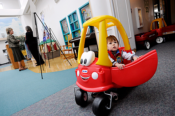 19-month-old Henry Wortman of Wytopitlock looks up to his mother, Angela Wortman (not pictured) as he exits a toy car during Monday afternoon's press conference on the pediatric floor at Eastern Maine Medical Center in Bangor.  EMHS officials announced Irving Oil's 2010 Fuel the Care Donation of $50,000 to participating hospitals of EMHS's Healthcare Charities' Children's Miracle Network. The Wortman family recently received assistance through the program. Henry was born premature on May 9, 2008 and remained in the neonatal instensive care unit there for 122 days after he was born. On December 1,2009 his little brother was also born premature at EMMC and the family recently received fuel assistance through the program so they can afford the commute between Wytopitlock and Bangor. Eligible families can receive gift cards issued by Irving which can be redeemed at Irving locations for gasoline and fuel items.