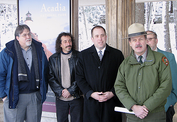 Acadia National Park Superintendent Sheridan Steele stands in front of state legislators Wednesday while commenting on a legislative proposal to reduce sulfur in home heating fuel in the next decade. Behind Steele, from left to right, are Rep. Brian Langley, Rep. Rob Eaton, Sen. Seth Goodall, and (partially obscured), Rep. Jim Schatz. (BANGOR DAILY NEWS PHOTO BY BILL TROTTER)