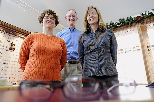 Left to right: Kimberly D. Allen, O.D., Jeffrey E. Sawyer, O.D., Kathy O. Ward, O.D., and Charles Marquez, O.D. (not present) are the four optometrists practicing at the newly-relocated Penobscot Eye Care at 29 Dirigo Drive in Brewer. The eye care business opened there on December 2, 2009--two months ahead of schedule, they said. (Bangor Daily News/John Clarke Russ)