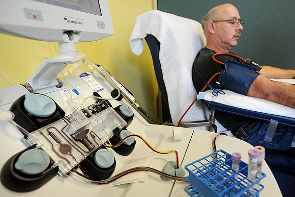 Charles Corliss of Cherrifield is hooked up to one of the apheresis machines that uses advanced technology to separate blood into it's components at the American Red Cross Blood Services office in Bangor Tuesday.  Corliss donated two units of red blood cells. (Bangor Daily News/Gabor degre)