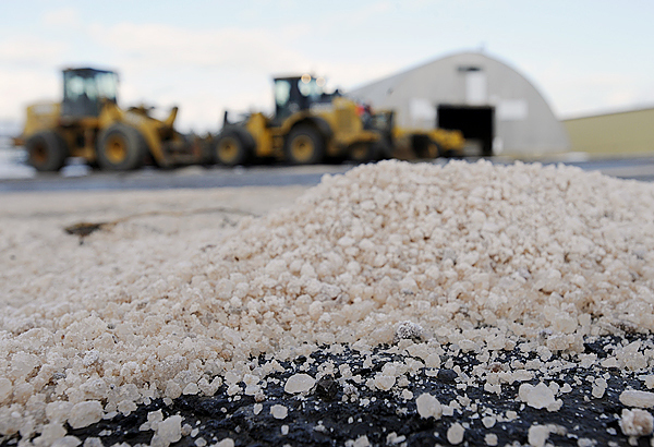 Rock salt from a front-end loader lays on the pavement at Bangor Public Work's facility off Maine Avenue as workers there prepared their trucks Tuesday afternoon for the forecasted snow storm. The National Weather Service has issued a storm watch in effect in northern Maine from Wednesday afternoon through Thursday Morning. (BANGOR DAILY NEWS PHOTO BY JOHN CLARKE RUSS)