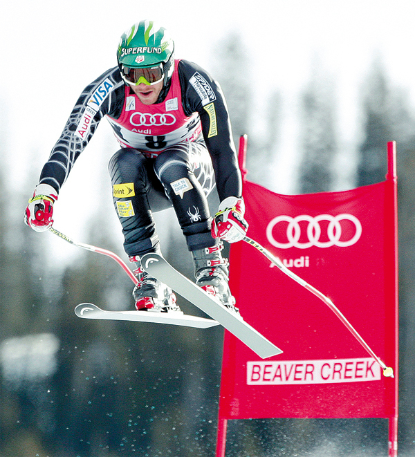Bode Miller of Easton, N.H. goes airborne past a gate at the men's World Cup downhill ski race on Saturday, Dec. 5, 2009, in Beaver Creek, Colo. (AP Photo/Charles Krupa)