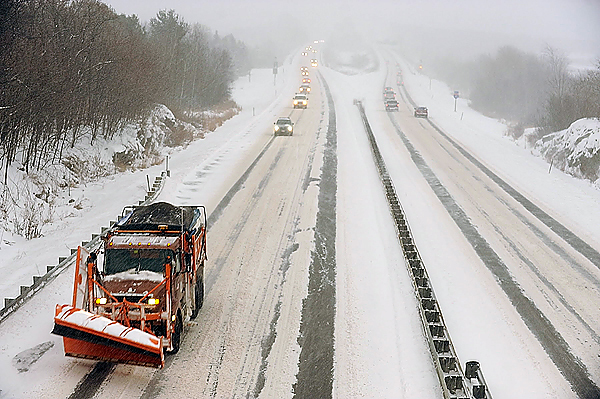 Viewed from the Essex Street overpass in Bangor, a public works truck in the  Interstate 95 southbound lane gets ready to make another sweep as snow continued to fall steadily just before 4 p.m. Wednesday, December 9, 2009. (Bangor Daily News/John Clarke Russ)