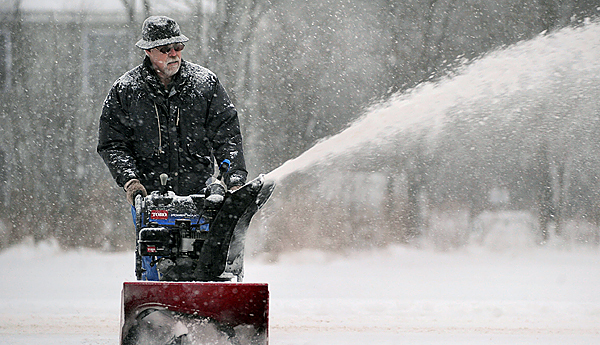 Rod McIntyre clears the snow from his driveway at his Brewer home.  Wednesday's snow storm had dropped almost 7 inches of snow by mid afternoon in the Bangor area. (Bangor Daily News/Gabor Degre)