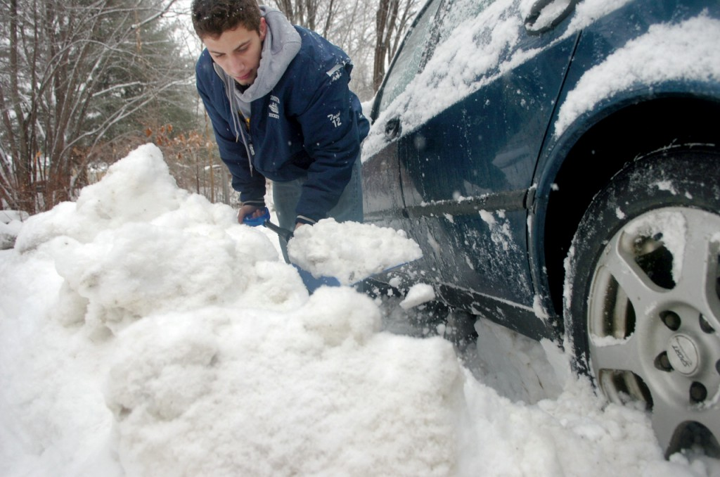 University of Maine junior Tony Tochi digs out his car at his Orono apartment Thursday morning, Dec. 10, 2009, before going to class. &quotI had a Suburu before and I never had to dig it out,&quot Tochi said, who also got a helpful push out of his parking spot from roommate Travis Jordan. (Bangor Daily News/Bridget Brown)