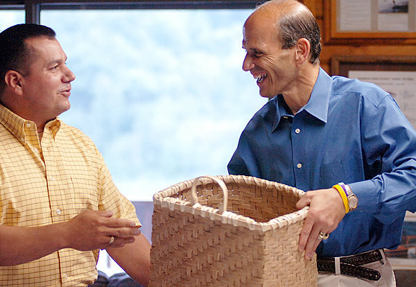 Passamaquoddy Gov. William Nicholas (left) of Indian Township presents Maine Gov. John Baldacci wit h a traditional Passamaquoddy basket for the next time he climbs Mount Katahdin. The presentation was made during the 2007 Assembly of Governors and Chiefs on July 19 at the Veazie Salmon Club.