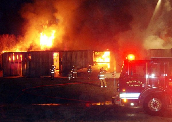 The Presque Isle Fire Department fought a fire at a  warehouse on Rice Street, responding jsut before 10 p.m. Friday. The building stored large rolls of paper and polyurethane for printing, also contained drums of ink, solvents and a large propane tank.