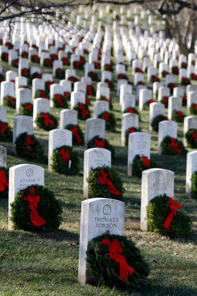 Wreaths adorn graves Saturday as part of Wreaths Across America at Arlington National Cemetery in Arlington, Va.