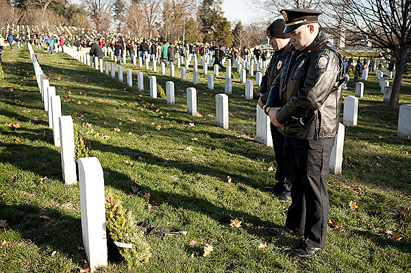 Dec. 12, 2009-Bangor native Glen McGary, an officer with the Portland police department, takes a quiet moment after placing a wreath at Arlington National Cemetery's annual wreath-laying ceremony. Thousands of volunteers showed up for the event, including officers from the Portland police and fire departments, the Scarborough and Westbrook police departments.