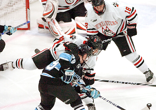 University of Maine freshman Joey Diamond (39) looks for an opening against Northeastern sophomore J.P. Maley in the second period of Saturday's game, Dec. 12, 2009 at the Alfond Arena in Orono. Maine won 5-1. (Bangor Daily News/Bridget Brown)