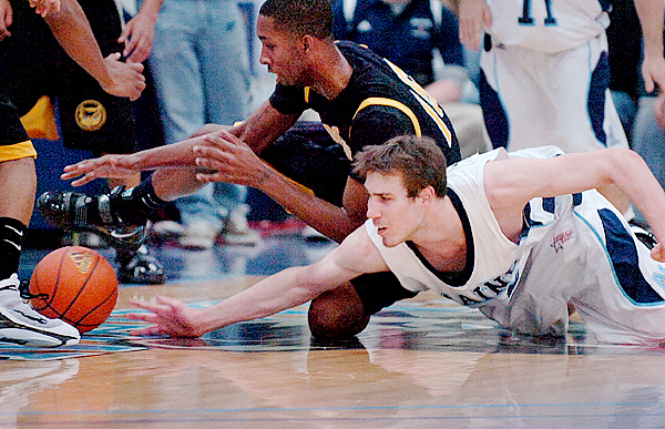 Kennesaw State's LaDaris Green (left) and UMaine's Mike Allison dive for a loose ball in the first half of Sunday's game, Dec. 13, 2009 at the Alfond Arena in Orono. (Bangor Daily News/Bridget Brown)