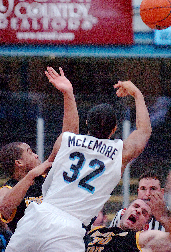 Kennesaw State's Jon-Michael Nickerson (lower right) reacts as UMaine's Gerald McLemore (32) goes up for a basket in the first half of Sunday's game, Dec. 13, 2009 at the Alfond Arena in Orono. (Bangor Daily News/Bridget Brown)