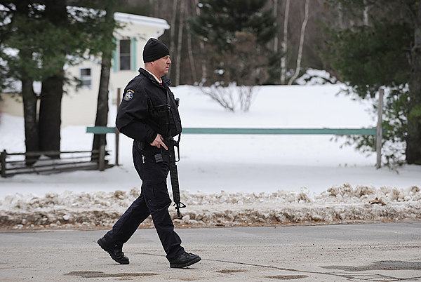 A Maine State Trooper watches over the intersection of Southgate Road and Rt. 16 in Old Town on Sunday, December 13, 2009 after a report of shots being fired in the area. A K-9 unit was called in to search the woods behind 29 Southgate Road.
