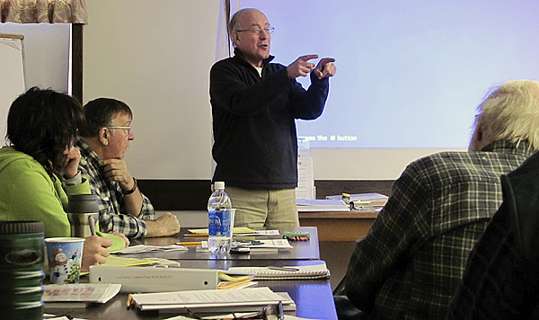 Charlie Wing of West Bath, a retired physics professor and expert on energy conservation, trains a class of volunteers who will weatherize homes in Somerset County. The day-long class, one of numerous such trainings occurring in Maine for the next few weeks, took place at the University of Maine Cooperative Extension's Skowhegan office on Sunday, December 13, 2009.  Bangor Daily News photo by Christopher Cousins