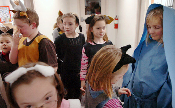 Children prepare to participate in the United Methodist Church of Old Town's Christmas pageant on Sunday, Dec. 13, 2009. Following the pageant, parishioners celebrated Christ's birthday with vanilla cupcakes. (Bangor Daily News/Bridget Brown)