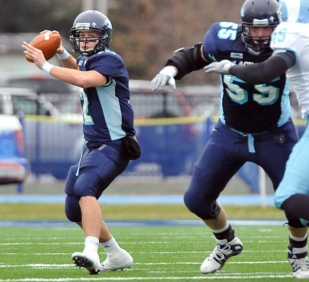Maine quarterback Chris Treister looks for a receiver while Matt Barber provides pass protection against Rhode Island in the second half at Alfond Stadium in Orono Saturday. Treister passed for 465 yards and five touchdowns in Maine's 41-17 victory.  (BANGOR DAILY NEWS PHOTO BY MICHAEL YORK)  CAPTION  Maine quarterback Chris Treister, (12), looks for a receiver downfiled with pass protection from Matt Barber, (55), in the second half of their NCAA football game in Orono, Maine, Saturday, Nov. 14, 2009. AP PHOTO BY MICHAEL YORK