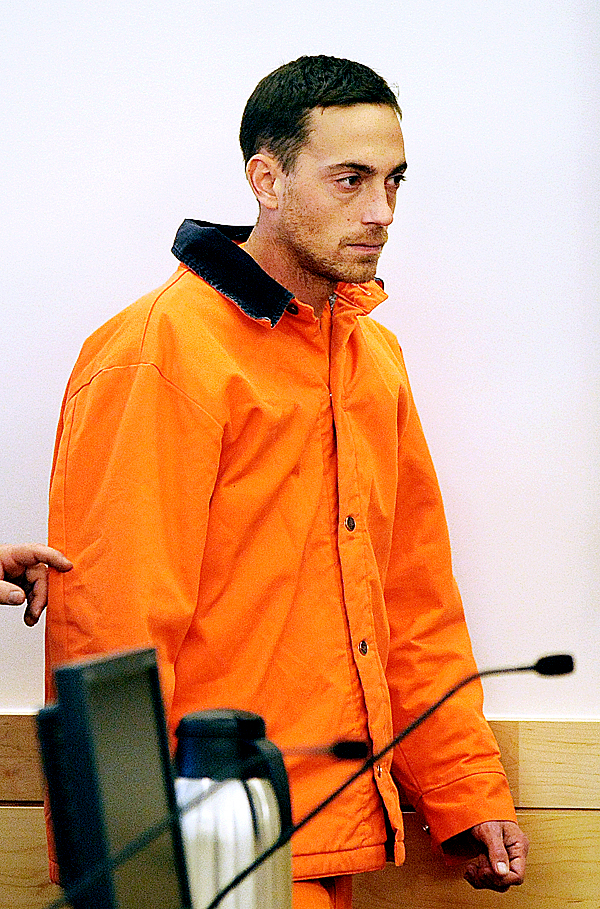 Nathaneal Nightingale walks into the courtroom at the Penobscot Judicial Center before his initial appearance for the alleged murder of Valerie Miller and Michael Miller Sr. in November of 2009.