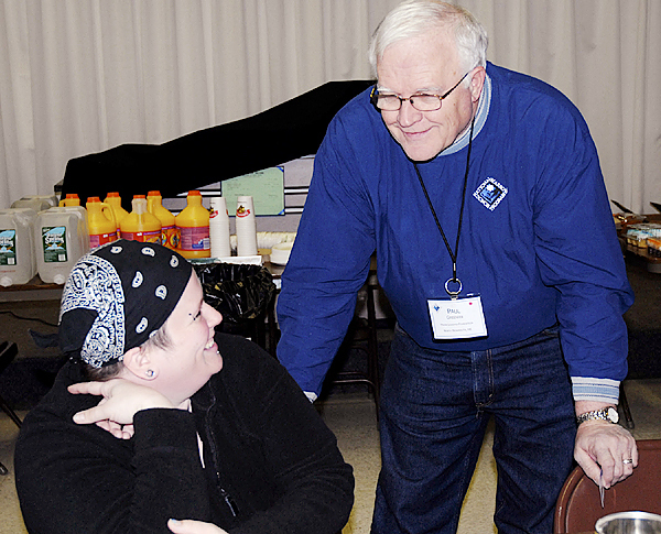 Paul Greenier of the Maine Leukemia Foundation spends a few moments with volunteer Mecca Hall at the bone marrow donor registry drive in Fort Kent Tuesday afternoon. Hall's friend Carrie Dechaine of Madawaska was diagnosed with leukemia last summer and is on the waiting list for a suitable match for a bone marrow transplant.