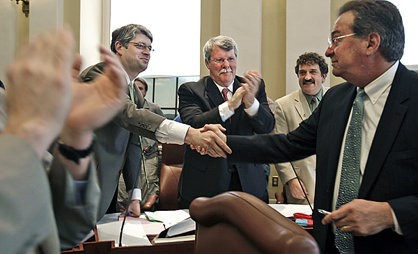 This May 6, 2009 file photo shows Sen. Lawrence Bliss, D- South Portland, right, an openly gay legislator, being congratulated by fellow lawmakers in the Senate chamber after they voted and gave final approval to a gay rights marriage bill at the State House in Augusta, Maine. Senators are, at  left, Joseph Perry, D-Bangor, Dennis Damon, D-Trenton, center, and Bruce Bryant, D-Dixfield. In November, Maine voters will become the first in any state with the chance to repeal or uphold a law passed in May by their legislature, legalizing same-sex marriage.