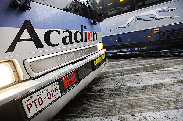 An Acadian Line bus was parked next to a Greyhound bus before its daily 11:45 a.m. departure from the Bangor bus terminal, bound for New Brunswick Tuesday, December 15, 2009. The Acadian Line may discontinue its overnight Bangor stop in Spring 2010.
