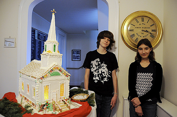 Pictured are Beck Brownlow and Lucy Jakub, both of Blue Hill. They are two of the youth who worked on this to-scale gingerbread model of the First Congregational Church of Blue Hill, which can be viewed in the Congregational Church?s entryway. Handworked details include stained glass windows, the open front door, and the gold weathervane atop the steeple. To buy a chance to win this confectionary masterpiece, contact the church at 374-2891 or come Sunday morning at 10:00 am. All proceeds go to the church?s kitchen fund.