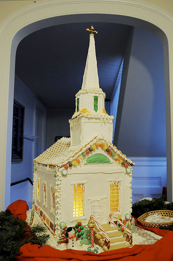 Beck Brownlow and Lucy Jakub (not pictured), both of Blue Hill, are two of the youth who worked on this to-scale gingerbread model of the First Congregational Church of Blue Hill, which can be viewed in the Congregational Church?s entryway. Handworked details include stained glass windows, the open front door, and the gold weathervane atop the steeple. To buy a chance to win this confectionary masterpiece, contact the church at 374-2891 or come Sunday morning at 10:00 am. All proceeds go to the church?s kitchen fund.