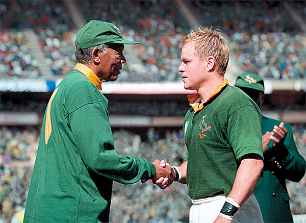 In this film publicity image released by Warner Bros.,Morgan Freeman portrays Nelson Mandela, left, and Matt Damon portrays Francois Pienaar in a scene from the film, &quotInvictus.&quot (AP Photo/Warner Bros.,Keith Bernstein)