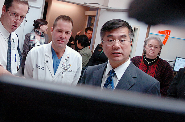 Eastern Maine Medical Center doctors Jonathan Wood (left) and Rafael Grossman demonstrate the teletrama technology the hospital uses to video conference with other hospitals to U.S. Commerce Secretary Gary Locke, right, on Thursday, Dec. 17, 2009.   His visit was to highlight an example that those who will benefit from broadband expansion include medical services and their patients.