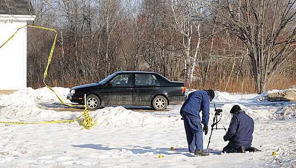 Maine State Police investigators document the scene of a shooting at a home near the intersection of the North Searsport Road and Monroe Road in Searsport.  It was one of two shootings in Searsport early Thursday morning that also involved a state trooper who was not injured.  Two people were transported to the hospital according a press release from the Maine Department of Public Safety.