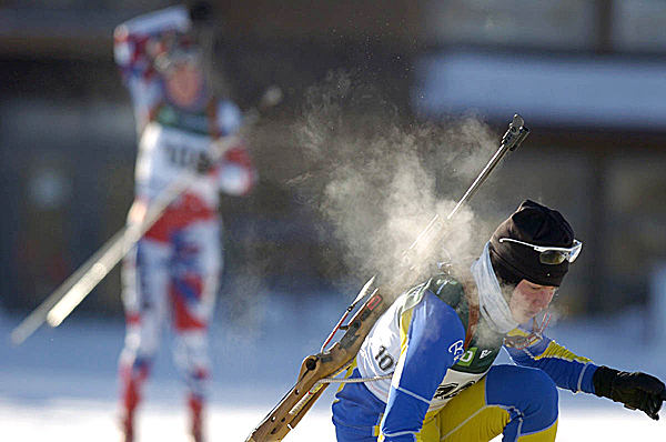 Haley Johnson of Lake Placid, N.Y. and a member of the Maine Winter Sport Center team, exhales into the 4 degree air Tuesday morning morning as she sets her ski's down to shoot during the women's 7.5-kilometer sprint at the U.S. Olympic biathlon trials in Fort Kent. Johnson was 16th in the women's standings at the end of qualifying. (BANGOR DAILY NEWS PHOTO BY JOHN CLARKE RUSS)